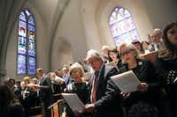 Mourners sing in the balcony during the funeral service for George H.W. Bush, the 41st President of the United States, at St. Martin's Episcopal Church in Houston, Thursday, December 6, 2018. (Tom Fox/The Dallas Morning News)