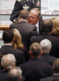 Former President George W. Bush gives a big hug to a friend as he enters the St. Martin's Episcopal Church in Houston for the funeral service of George H.W. Bush, the 41st President of the United States, Thursday, December 6, 2018. (Tom Fox/The Dallas Morning News)