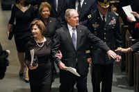 Former President George W. Bush and First Lady Laura Bush are greeted by well-wishers during the funeral recessional for George H.W. Bush, the 41st President of the United States, at St. Martin's Episcopal Church in Houston, Thursday, December 6, 2018. (Tom Fox/The Dallas Morning News)(<div><br></div><div><br></div>)