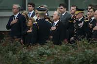 From left Jeb Bush and his wife Columba Bush and former President George W. Bush and his wife Laura Bush stand for the national anthem  before President George H.W. Bush's internment close to his presidential library on Thursday, Dec. 6, 2018, in College Station, Texas. (Smiley N. Pool/The Dallas Morning News)