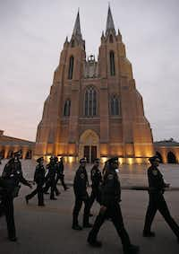 Houston Police officers make their way to their positions before the funeral service for George H.W. Bush, the 41st President of the United States, at St. Martin's Episcopal Church in Houston on Thursday, December 6, 2018. (Louis DeLuca/The Dallas Morning News)