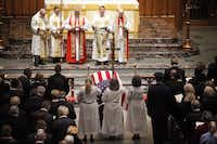 Reverend Russell J. Levenson, Jr (second from right) leads the clergy before the funeral service recessional for George H.W. Bush, the 41st President of the United States, at St. Martin's Episcopal Church in Houston, Thursday, December 6, 2018. (Tom Fox/The Dallas Morning News)