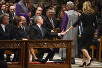 Former President George W. Bush reaches out to his daughter Jenna Bush Hager after she did a reading during the State Funeral for George H.W. Bush, the 41st President of the United States, at the Washington National Cathedral on Wednesday, Dec. 5, 2018, in Washington. (Smiley N. Pool/The Dallas Morning News)