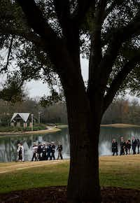 The flag-draped casket of President George H.W. Bush is followed by his family as he is carried to a burial plot close to his presidential library for internment on Thursday, Dec. 6, 2018, in College Station, Texas. (Smiley N. Pool/The Dallas Morning News)(<br>/<br>)
