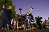 Felipe Cuellar, 36, of Dallas, views the planet Saturn through a telescope during a Mars viewing event hosted by the Texas Astronomical Society of Dallas at Brookhaven College July 31, 2018.(Ben Torres/Special Contributor)