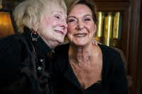 "Ann ""Auntie"" Sanford, left, embraces her sister, Sara Munroe.(Carly Geraci/Staff Photographer)"