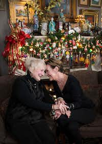 "Sisters Ann ""Auntie"" Sanford (left) and Sara Munroe, haven't missed a Christmas Eve together in 75 years. (Carly Geraci/Staff Photographer)"