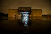 The parking-lot lights aren't lit at the Dollar General in the 4800 block of Sunnyvale Street.(Daniel Carde/Staff Photographer)
