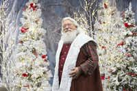 Santa Claus poses for a portrait this month at his Winter Woods setting at  Fairview Town Center in the Collin County city of  Fairview.(Daniel Carde/Staff Photographer)