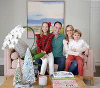KXAS anchor Meredith Land poses for a photo with her husband, Xan, son Alexander and daughter McCall at their Dallas home.(Tom Fox/Staff Photographer)