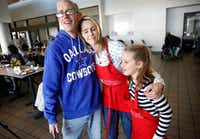 Meredith Land gives Reid Holiday, who is hearing impaired, a hug after serving lunch with daughter McCall and family at Salvation Army's Carr P. Collins Social Service Center in Dallas.(Tom Fox/Staff Photographer)