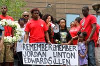 Sara Mokuria (center, with bullhorn) led a May 2017 rally on the steps of Dallas' Frank Crowley Courts Building with family members of Jordan Edwards, the 15-year-old shot and killed by a Balch Springs police officer.(Ron Baselice/Staff Photographer)