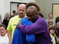 Krum High assistant principal Bernard Lightfoot (right)  is consoled by supporters after his recent resignation.(Jeff Woo/Denton Record-Chronicle)
