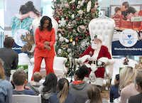 Former first lady Michelle Obama dances after a patient at Children's Hospital Colorado in Aurora, Colo., asks her about her favorite moves.(Thomas Peipert/AP)