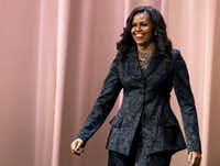 "Former first lady Michelle Obama walks on stage during a stop on her book tour for ""Becoming,"" in Washington.(Jose Luis Magana/AP)"