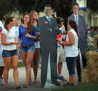 Lynn University students in Boca Raton, Fla., took an interest in cardboard cutouts of both candidates as the campus prepares for Monday's final presidential debate.
