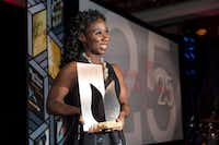 Esi Edugyan poses for a photo on stage after winning the Scotiabank Giller Prize for  <i>Washington Black</i> at the gala in Toronto on Monday, Nov. 19, 2018. (Chris Young/AP)