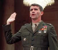 Lt. Col. Oliver North was sworn in before the congressional Iran Contra Committee. Court records say James Balagia's co-defendant, Chuck Morgan, was connected with a man who was possibly caught up in the arms scandal. (File Photo/The Associated Press)
