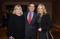 Linda Perryman Evans, John Meadows and Elise Meadows at Dallas CASA's annual dinner in November. The Meadows Foundation received this year's Judge Barefoot Sanders Champion of Children Award.(Kristina Bowman Photography)