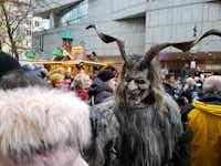 Around 300 Krampuses run amok at the Munich Christmas market.(Travis Pinson/Special Contributor)