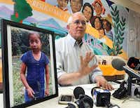 <p>Annunciation House director Ruben Garcia answers questions from the media after reading a statement from the family of Jakelin Caal Maquin (pictured at left) during a press briefing Saturday at Casa Vides in downtown El Paso.</p>(Rudy Gutierrez/The Associated Press)