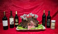 """<p></p><p>A crown roast paired with wines from Texas Fine Wine:<span style=""""font-size: 1em; background-color: transparent;""""></span><span style=""""font-size: 1em; background-color: transparent;"""">2014 Spicewood Vineyards Good Guy, 2015 Duchman Family Winery Aglianico, 2015 Bending Branch Winery Texas Tannat, 2016 Pedernales Cellars Texas Tempranillo, and</span><span style=""""font-size: 1em; background-color: transparent;"""">Brennan Vineyards W (Winemakers Choice Vol. IV).</span></p><p></p>(Carly Geraci/Staff Photographer)"""