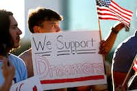 Jordin Chavez stands in the crowd with a sign during a support rally for DACA recipients at City Hall Plaza in Dallas on Wednesday, Sept. 6, 2017.(Rose Baca/Staff Photographer)