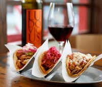 Tacos (from left) chicken tinga, chochinita pibil and crispy pork carnitas paired with Ludovicus garnacha(Rose Baca/Staff Photographer)