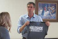 Rep. Beto O'Rourke campaigns in Muleshoe, Texas, on July 31, 2018. Hosts gave him Muleshoe swag, including locally made corn chips and a Muleshoe T-shirt.(Todd J. Gillman/staff)