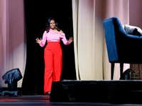 Former first lady Michelle Obama said it took her a while to warm up to would-be husband Barack Obama when they first met as college students.(Vernon Bryant/Staff Photographer)