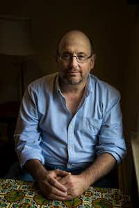Author Kurt Eichenwald poses for a photograph at Crooked Tree Coffee House in Dallas. (Carly Geraci/Staff Photographer)