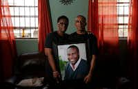 Allison and Bertrum Jean hold a photo of their son Botham Shem Jean at their home in Castries, St. Lucia.(Vernon Bryant/Staff Photographer)