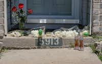 A small memorial formed on the front step of 5913 Mimosa Lane in Rowlett on May 7. Policarpo Gonzalez-Flores, 40, shot his 11-year-old son,  James Gonzalez, before killing himself on May 5, according to authorities.(Ron Baselice/Staff Photographer)