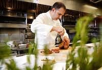 Executive chef Sebastien Archambault carves a roasted duck a l'orange(Rose Baca/Staff Photographer)