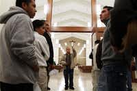 Father Edmundo Paredes spoke with church ushers during last-minute preparations for St. Cecilia's new church dedication Mass and ceremony in November 2011.(File Photo)