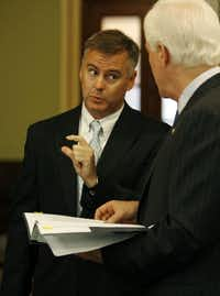 Reed O'Connor, shown here when he was the newest federal judge in North Texas, chats with U. S. Senator John Cornyn of Texas.(Getty Images)