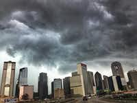 Ominous looking storm clouds roll over downtown Dallas, Monday afternoon, October 8. Dime-sized hail was reported with some of these storms that were moving south to north through Dallas, Collin and Denton counties.(Tom Fox/Staff Photographer)