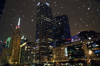Downtown Dallas looked like the inside of a snow globe in this photo taken Monday evening, January 15, as a mixture of snow and sleet began falling in downtown Dallas as a cold front slowly moved across the area.(Tom Fox/Staff Photographer)