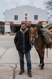 Jerry Andrews, of Friendship, Okla., and his horse Speck at Coke County Cowboy Church in Bronte, Texas, on Dec. 16, 2018. Andrews said God told him to get on his horse and travel from Oklahoma to San Angelo, Texas, to give money to a friend who needed help. While riding though Bronte on his way home he passed the church, and a member of the congregation put him up for the night.(Carly Geraci/Special Contributor)