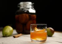 Cinnamon Pear Old-Fashioned with infused bourbon by Alex Fletcher(Vernon Bryant/Staff Photographer)