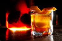 Charred Orange Old Fashioned, an infused cocktail made with a charred orange infused bourbon at Harvest Seasonal Kitchen(Vernon Bryant/Staff Photographer)