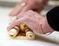 Gently roll up each of the sides of the puff pastry in order to make palmiers (Nathan Hunsinger/Staff Photographer)