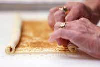 Gently roll up each of the sides of the puff pastry in order to make palmiers(Nathan Hunsinger/Staff Photographer)