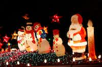 Snowmen congregate with Santa atop Simmons' home in Old East Dallas.(Michael Ainsworth/Special Contributor)