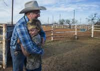 Pastor James Brunson (left) hugs Joseph McClure after a roping outreach event at the Coke County Cowboy Church arena. McClure, who lives in Japan because of his father's work, was visiting family in Bronte.(Carly Geraci/Special Contributor)