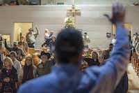 Congregation members raise their hands during a service at Coke County Cowboy Church.(Carly Geraci/Special Contributor)