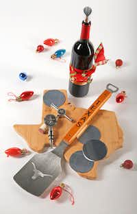Bamboo Texas Cutting Board, NCAA Texas Longhorns Classic Series Sportula Spatula, Western Star Corkscrew and Wine Stopper Set and Drop Stop Pour Discs (Nathan Hunsinger/Staff Photographer)