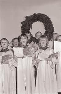 In this undated photo, a choir at Buckner Orphans Home in Dallas sings during a Christmas season gathering.(Buckner International)