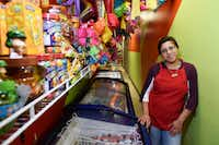 "<p><span style=""font-size: 1em; background-color: transparent;"">Marymar Nuñez, 19,stands near the many freezers used for icy treats at La China Poblana, a snack and ice cream store along Jefferson Boulevard in Dallas.</span></p>(Ben Torres/Special Contributor)"