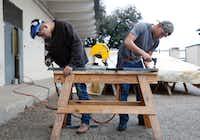 Sophomore Diego Reyes (left) and junior Alvaro Luna Jr. grind their welds during shop class at Skyline High School.(Nathan Hunsinger/Staff Photographer)
